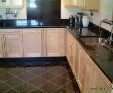 Black granite worktops with mathing granite tiles