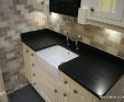 Black granite in satin finish worktop with belfast sink