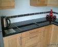 Black granite (Nero Assoluto) kitchen