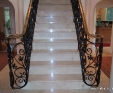 Crema Marfil marble staircase with full bullnose edge